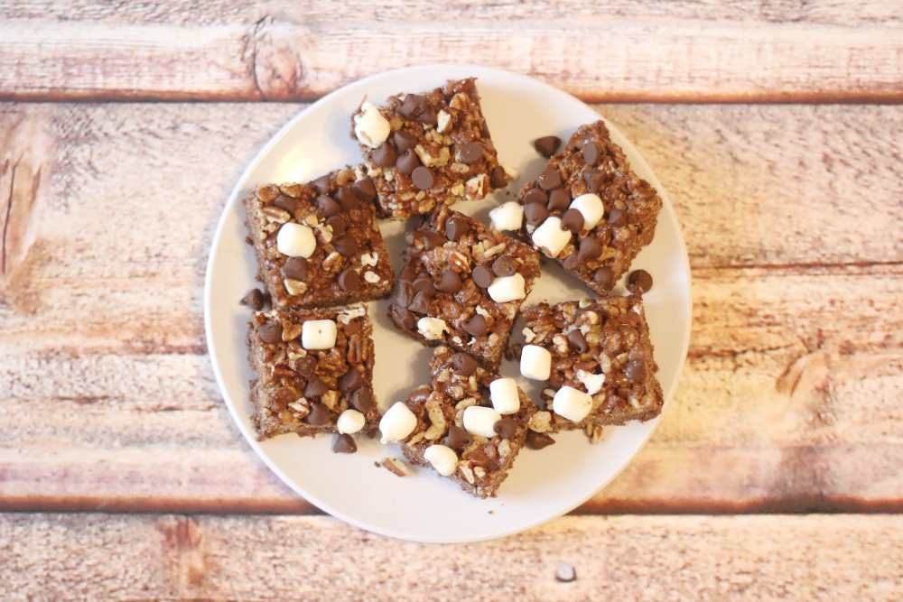 This recipe for Nutella rocky road rice krispie treats tastes so rich and indulgent that no one will believe they're a simple no-bake dessert made with rice krispies cereal!