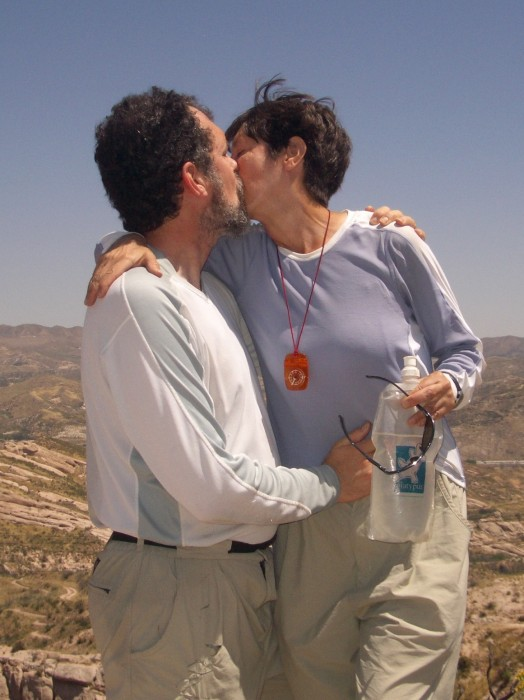 Porter and Gail Storey kissing on Pacific Crest Trail